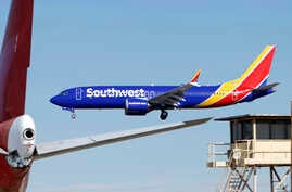 FILE - In this March 23, 2019, file photo, a Southwest Airlines Boeing 737 Max aircraft lands at the Southern California…