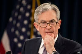 Federal Reserve Chair Jerome Powell pauses as he speaks during a news conference following the Federal Open Market Committee…