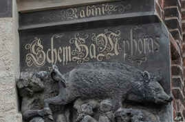 """In this Tuesday, Jan. 14, 2020 photo the so-called """"Judensau,"""" or """"Jew pig,"""" sculpture is displayed on the facade of the…"""