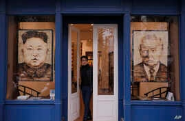 Artworks featuring U.S. President Donald Trump and North Korean leader Kim Jong Un are displayed at a gallery in Thursday, Feb…