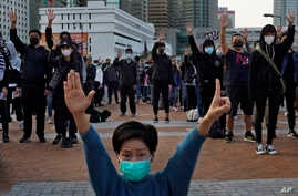 Protesters raise five demands gestures during a rally in Hong Kong, Sunday, Jan. 12, 2020. More than a thousand people attended…