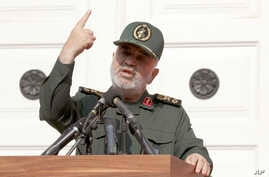 Chief of Iran's Revolutionary Guard Gen. Hossein Salami speaks in a ceremony to unveil new anti-U.S. murals painted on the…