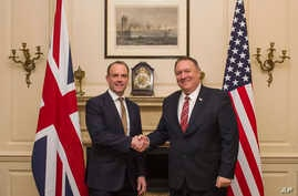 UK Foreign Secretary Dominic Raab shakes hands with US Secretary of State Mike Pompeo, right, in London, Wednesday Jan. 29,…