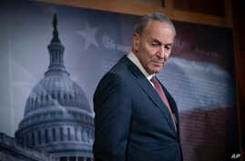 Senate Minority Leader Chuck Schumer, D-N.Y., pauses as he speaks to reporters to criticize the process in the Republican…