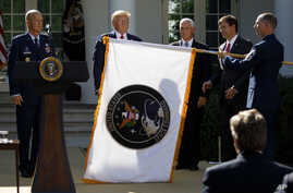"From left, Gen. John ""Jay"" Raymond, President Donald Trump, Vice President Mike Pence, and Secretary of Defense Mark Esper,…"