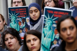 Demonstrators listen to speakers during a rally outside the U.S. 4th Circuit Court of Appeals Tuesday Jan 28, 2020, in Richmond…
