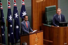 Indonesia's President Joko Widodo, left, address the Australian Parliament in Canberra, as the speaker of the house, Tony Smith…
