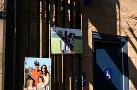 Pictures of the Altobelli family are shown at the entrance of the Orange Coast College baseball stadium prior to a ceremony…