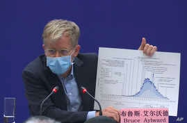 Bruce Aylward, an assistant director-general of the World Health Organization speaks with a chart during a press conference in…