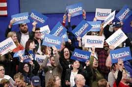 Supporters cheer during a election night rally for Democratic presidential candidate Sen. Bernie Sanders, I-Vt., in Manchester,…