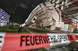A scaffold has toppled over due to heavy wind in Freiburg, Germany, Monday, Feb. 10, 2020. A storm battered the U.K. and…