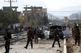 Afghan security personnel gather at the site of car bomb attack in Kabul, Afghanistan, Wednesday, Nov. 13, 2019. A car bomb…
