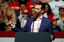 Donald Trump Jr. speaks at a rally before his dad and President Donald Trump appears Wednesday, Feb. 19, 2020 in Phoenix. (AP…