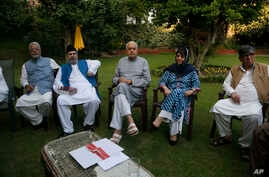 Former Jammu and Kashmir Chief Minister Mehbooba Mufti, second right,National Conference president Farooq Abdullah, center and…