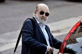 FILE - In this April 3, 2018 file photo, Argentine Federal Judge Claudio Bonadio arrives to court in Buenos Aires, Argentina…