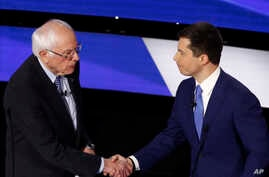 Democratic presidential candidates Sen. Bernie Sanders, I-Vt., left and former South Bend Mayor Pete Buttigieg shake hands…