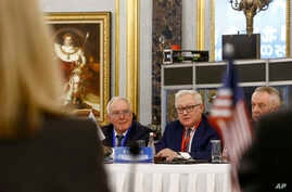 Russian Deputy Foreign Minister Sergey Ryabkov, center, head of a delegation, looks at a U.S. delegation, foreground, as he…