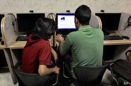 FILE -- In this  Monday, May 27, 2013 file photo, an Iranian man uses a computer at an Internet cafe, in Tehran, Iran, Monday,…