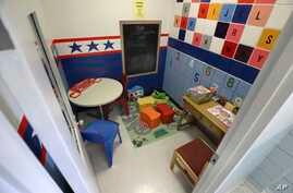 In this Wednesday, March 4, 2020, photo, toys and colorful paint fill a play room at the new visiting room of the Cybulski…