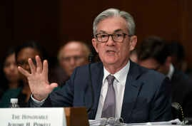 Federal Reserve Chairman Jerome Powell testifies before the Senate Banking Committee on Capitol Hill in Washington, Wednesday,…