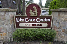A sign at the entrance of the Life Care Center is shown in Kirkland, Wash., near Seattle, Tuesday, March 3, 2020. Dozens of…