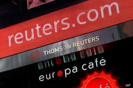 FILE - In this file photo made Jan. 19, 2010, the logo of Thomson Reuters is shown on its building in New York. News and…