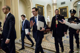 Treasury Secretary Steven Mnuchin, third from left, and White House Legislative Affairs Director Eric Ueland, left, walk to a…