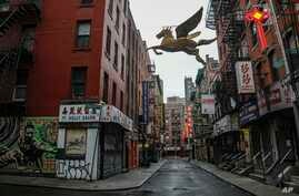A street in New York's Chinatown is empty, the result of citywide restrictions calling for people to stay indoors and maintain…