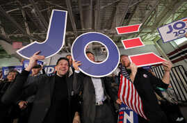 Supporters cheer at a primary election night rally for Democratic presidential candidate former Vice President Joe Biden in…