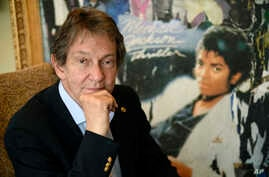 Entertainment and corporate lawyer John Branca, the co-executor of Michael Jackson's estate, poses in his office next to an…
