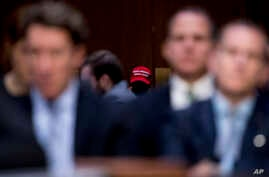 A member of the audience wears a pro-Trump hat as Department of Justice Inspector General Michael Horowitz testifies at a…