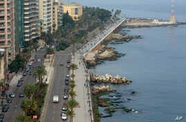 An aerial view shows the waterfront promenade along the Mediterranean Sea being mostly empty after police order people to…
