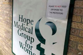 A sign outside the Hope Medical Group for Women in Shreveport, La., on Feb. 20, 2020 asks people not to speak to or feed…