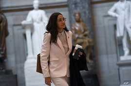 Rep. Alexandria Ocasio-Cortez, D-N.Y., walks Capitol Hill in Washington, Friday, March 27, 2020. (AP Photo/Susan Walsh)