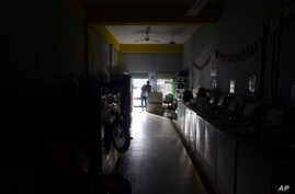 Laundromat owner Jesus Vazquez pauses before closing his shop to comply with the government's curfew aimed at curbing the…