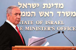 Prime Minister Benjamin Netanyahu approaches the podium to give a speech from his Jerusalem office on Saturday, March 14, 2020,…