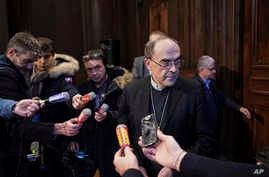 Cardinal Philippe Barbarin speaks during a press conference in Lyon, central France, after a French appeals court acquitted him…