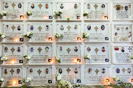 Candles are lit on a memorial wall during an anniversary memorial service to remember those who died when Ethiopian Airlines…