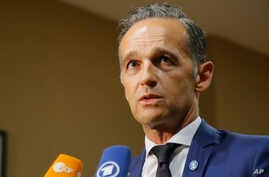 German Foreign Minister Heiko Maas, speaks to the media after a meeting on divisive migrant issue in Paris, France, July 22,…