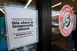 A sign is posted on a closed store, Thursday, April 23, 2020, in North Miami, Fla. A half million Floridians applied for…