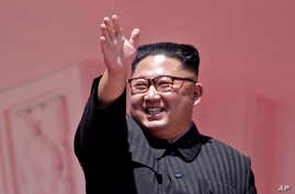 FILE - In this Sunday, Sept. 9, 2018 file photo, North Korean leader Kim Jong Un waves after a parade for the 70th anniversary…