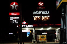 Gas prices are displayed in Hattiesburg, Miss., Sunday night, April 26, 2020. The historic crash in oil prices in the wake of…