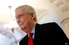 Senate Majority Leader Mitch McConnell of Ky., walks to his office on Capitol Hill in Washington, Thursday, April 9, 2020…
