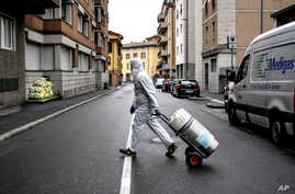 A staffer delivers a medical oxygen tank to coronavirus patients who are being treated at home, in Bergamo, one of the areas…