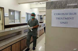 A Pakistan doctor enters an isolation ward set up as a preventative measure following the deadly Coronavirus outbreak, at the…