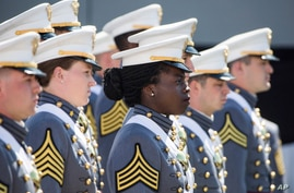 West Point cadets stand at their seats at the start of graduation ceremonies at the United States Military Academy, Saturday,…