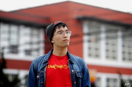 In this March 31, 2020, photo, Kyle Navarro poses in San Francisco. The school nurse was recently unlocking his bicycle when an…