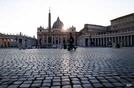 Police officers patrol an empty St. Peter's Square at the Vatican, Friday, April 10, 2020. Pope Francis began the Good Friday…