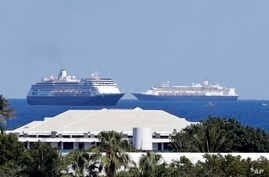 The cruise ships Zaandam, foreground, and Rotterdam make their way to Port Everglades, Thursday, April 2, 2020, in Fort…