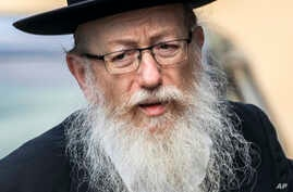 In this Monday, March 2, 2020, photo, Israel's Health Minister Yaakov Litzman visits a makeshift tent for quarantined…